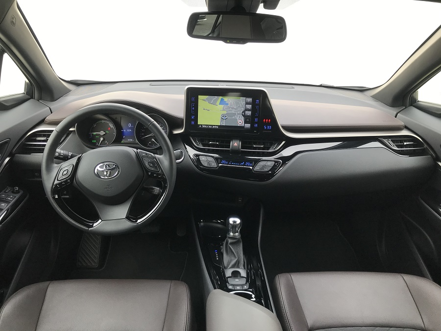 Grey Toyota C-HR, interior, steerinng wheel, navigation, transmission and front seats, dealer Auto Faltys
